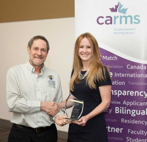 Dr. Roger Strasser, Dean of the Northern Ontario School of Medicine, presents the 2014 Sandra Banner Student Award for Leadership to Dr. Sarah Mary McIsaac during the CaRMS Forum at the Canadian Conference of Medical Education in Ottawa.