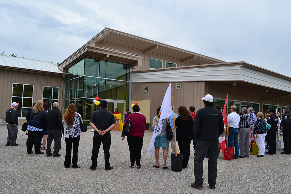 A large group of community members and dignitaries gather for the grand opening of the Aundeck Omni Kaning Multi-Use Recreation and Cultural Complex.