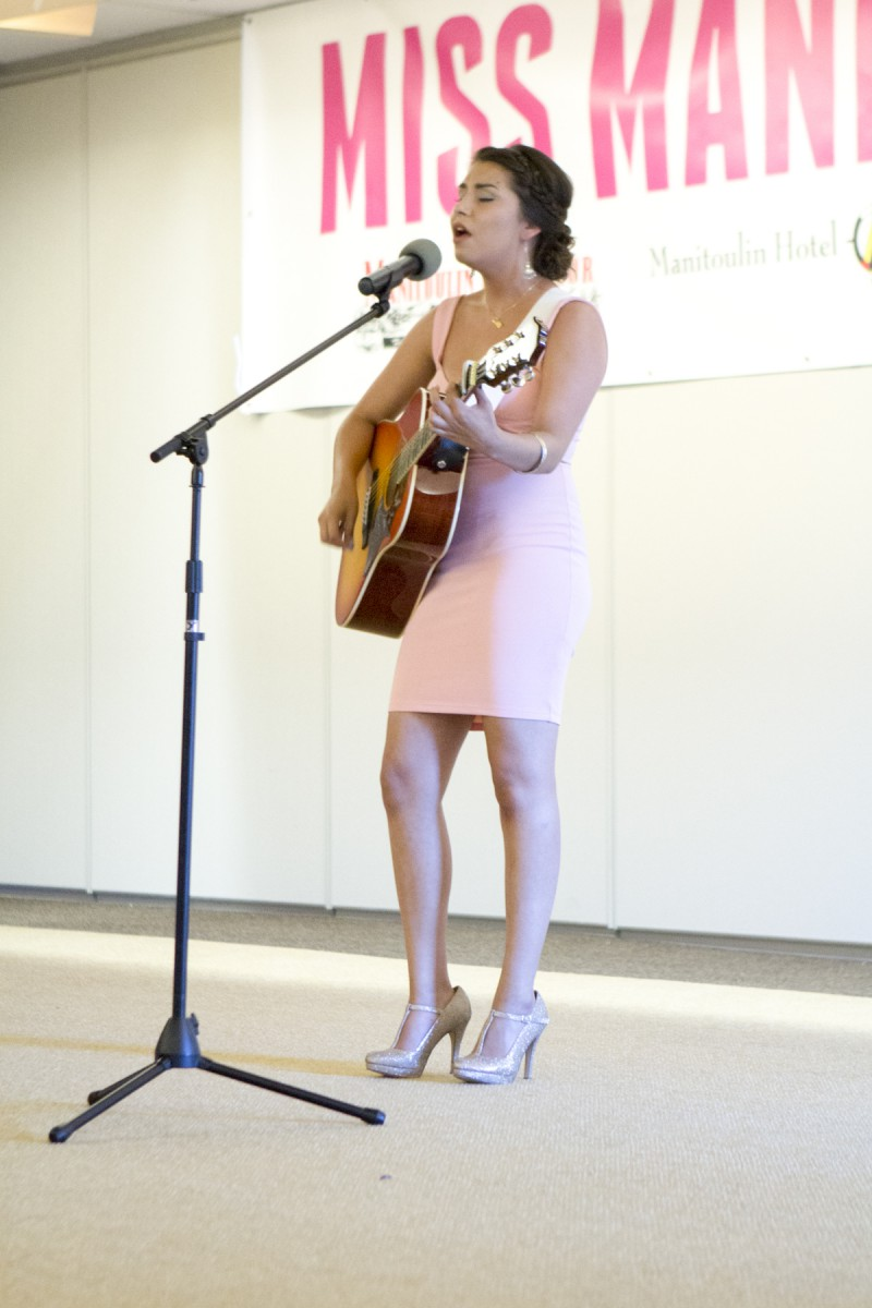 Brittany Manitowabi performs her song 'Field of Dreams' at the 2015 Miss Manitoulin pageant. photo by Rebecca Wright Photography