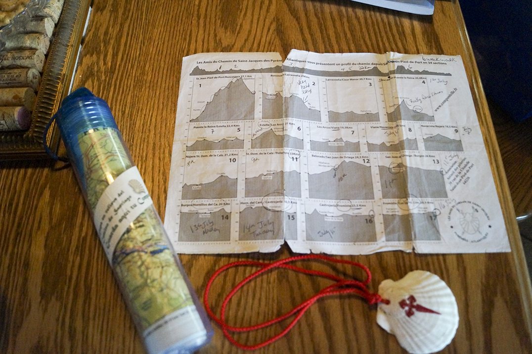 """The three essentials on the pilgrimage: topographical map (in the tube), pamphlet with recommended """"daily"""" walk during the 34-day trip and a sea shell to be tossed in the ocean at the completion of the pilgrimage. photos by Sharon Jackson"""