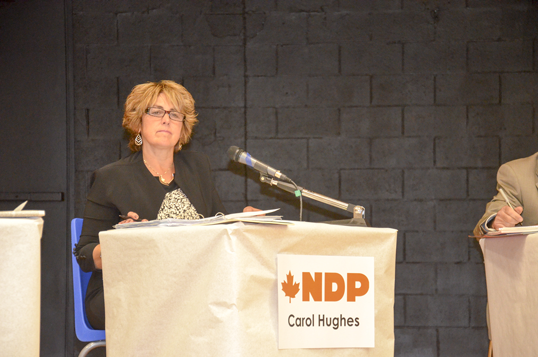 Carol Hughes, NDPMP incumbent, takes in a question from the floor.