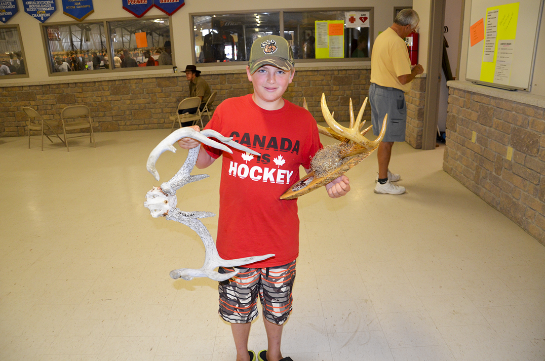 Hunter Smith, age 11, of Mindemoya shows off his antlers.