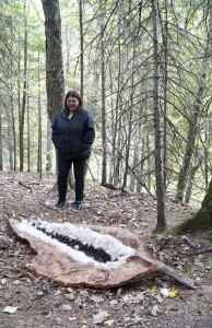 """Ann Marie Hadcock of Wiarton uses burlap, resin and layers of sawdust to create a giant """"seed pod."""" This piece blends in as it is tucked among trees along the winding Bridal Veil Falls hiking trail. photos by Sharon Jackson"""