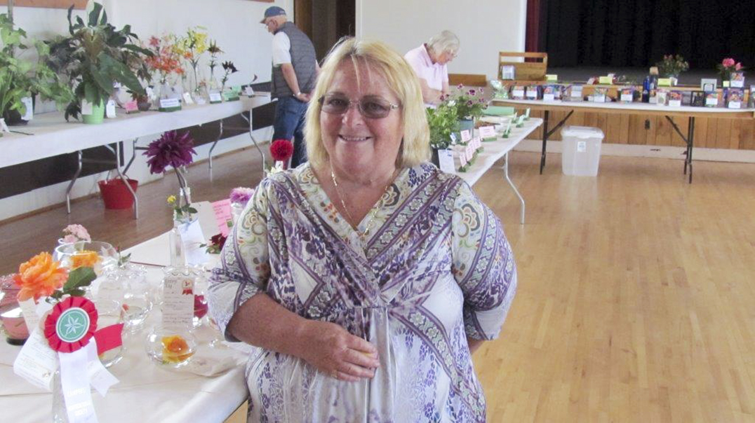 Sandra Strong is pictured with her award winning rose at the  Campbell Horticultural Society flower show.