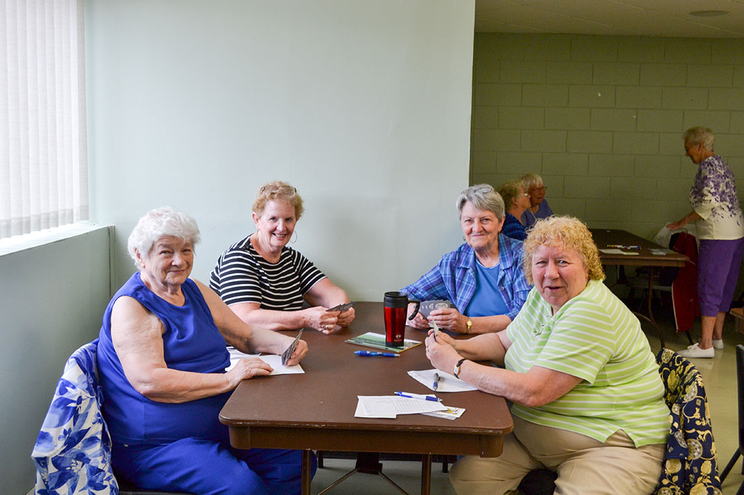 Four queens! These lovely ladies enjoyed Sunday afternoon's euchre tournament.