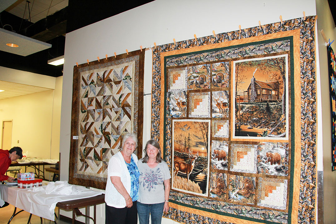 Pictured are first prize winner in the quilt raffle  Carol Farrar of Clarksbury with Current Quilts and Stitchery Guild President Gwen Bond. The  second prize winner was Brenda Monaghan of  Whitefish Falls.