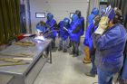 Kenj-welding-sparks-a-flying-with-Kathrine-Corbiere-and-students