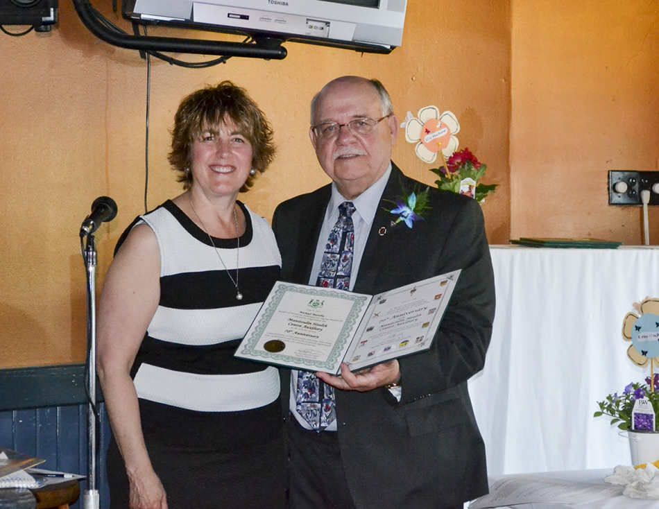 Algoma-Manitoulin-Kapuskasing MP Carol Hughes presents Little Current Hospital Auxiliary President Dave Sylvester with a certificate recognizing the auxiliary's 70th anniversary. photos by Robin Burridge