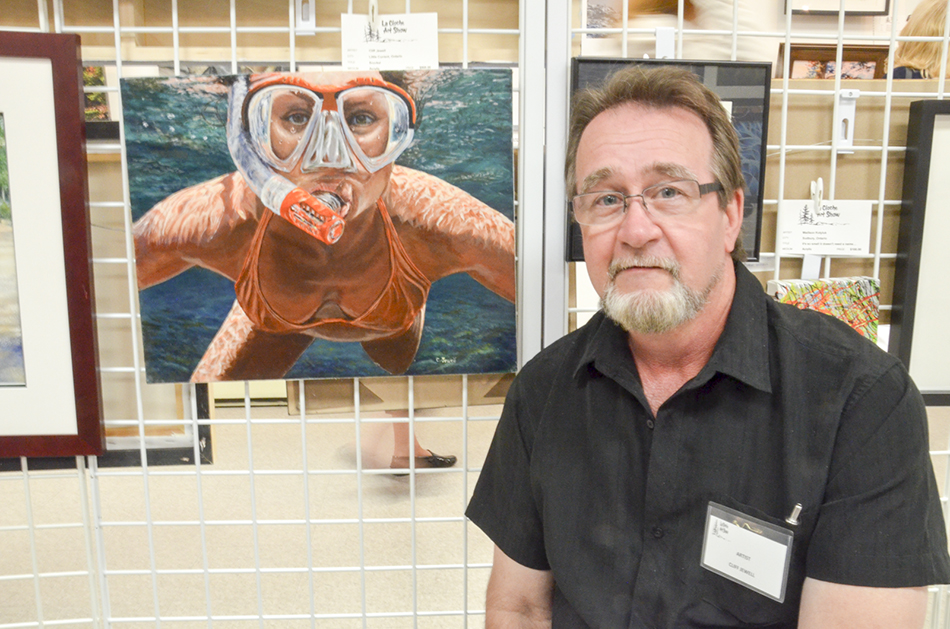 Little Current artist Cliff Jewell with one of his three entries in this year's show.