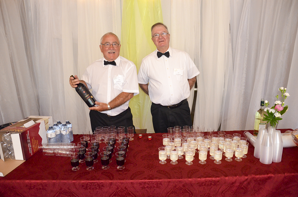 Wine stewards at the show opening served up  refreshments.