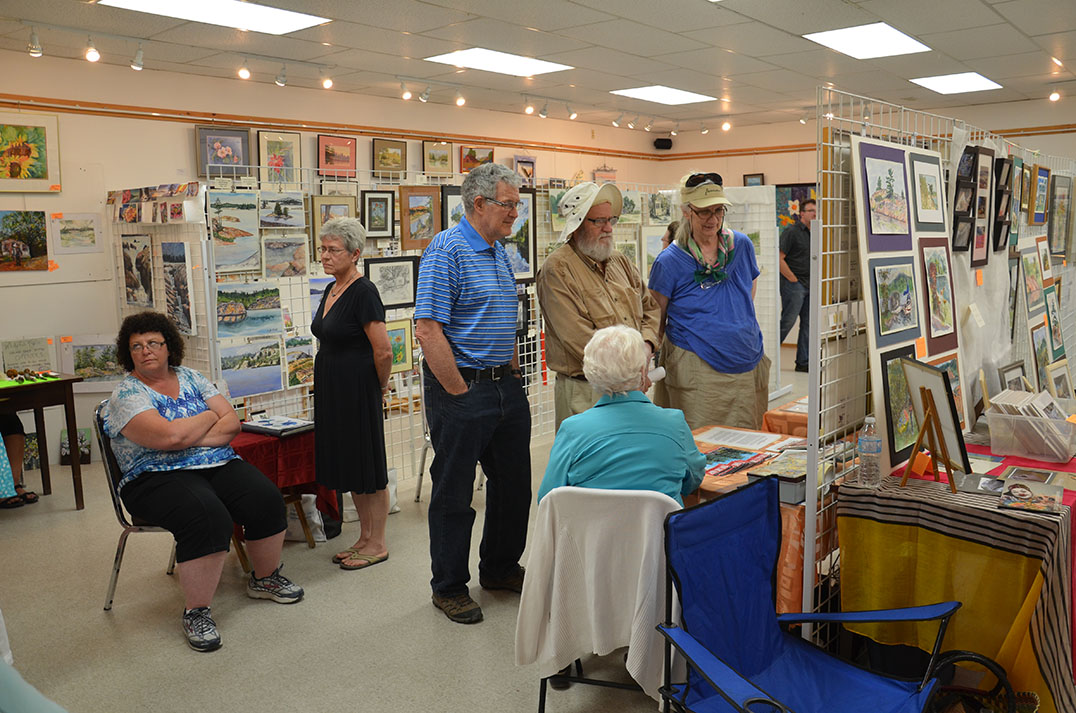 Art lovers and students admired the many works on display at the Whitefish Falls Community Centre as part of the LaCloche Art School's 30th anniversary alumni exhibition.