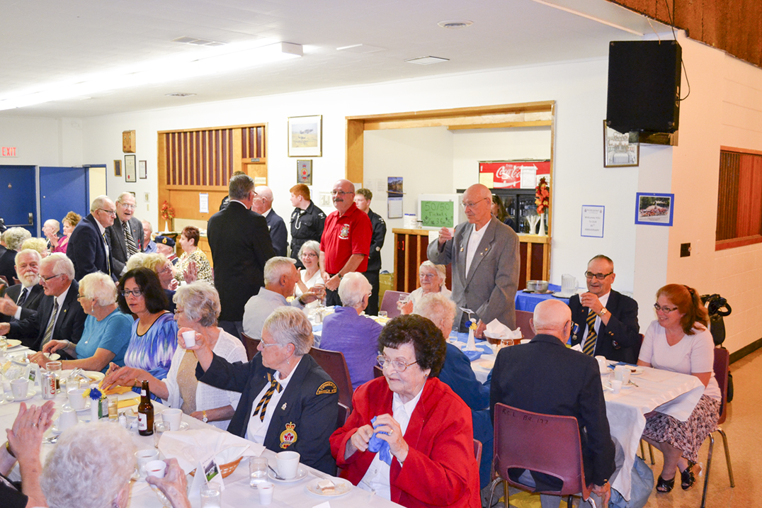 Veterans stand for a toast during the Royal Canadian Legion Branch #177 85th anniversary dinner and awards night. photos by Alicia McCutcheon