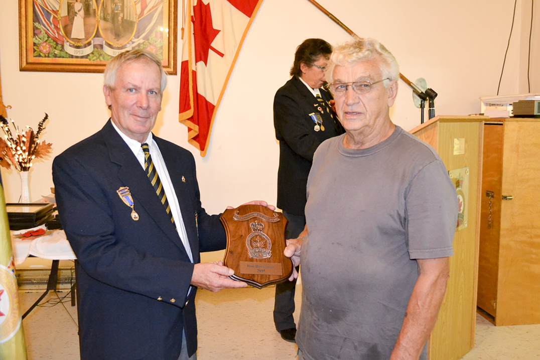 Comrade Tom Stephens presents Ron Bowerman, right, with the Legionnaire of the Year Award for his many volunteer efforts with the branch.