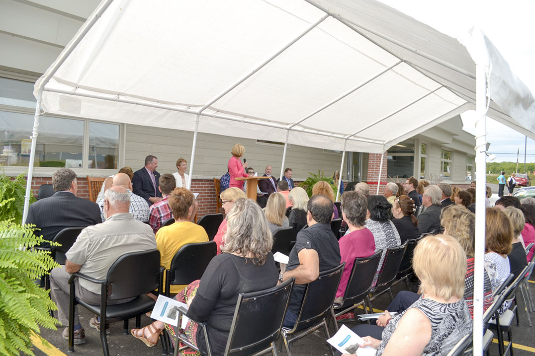 A large group of dignitaries and community members gathers for the opening ceremonies of the long-awaited Manitoulin Central Family Health Team.