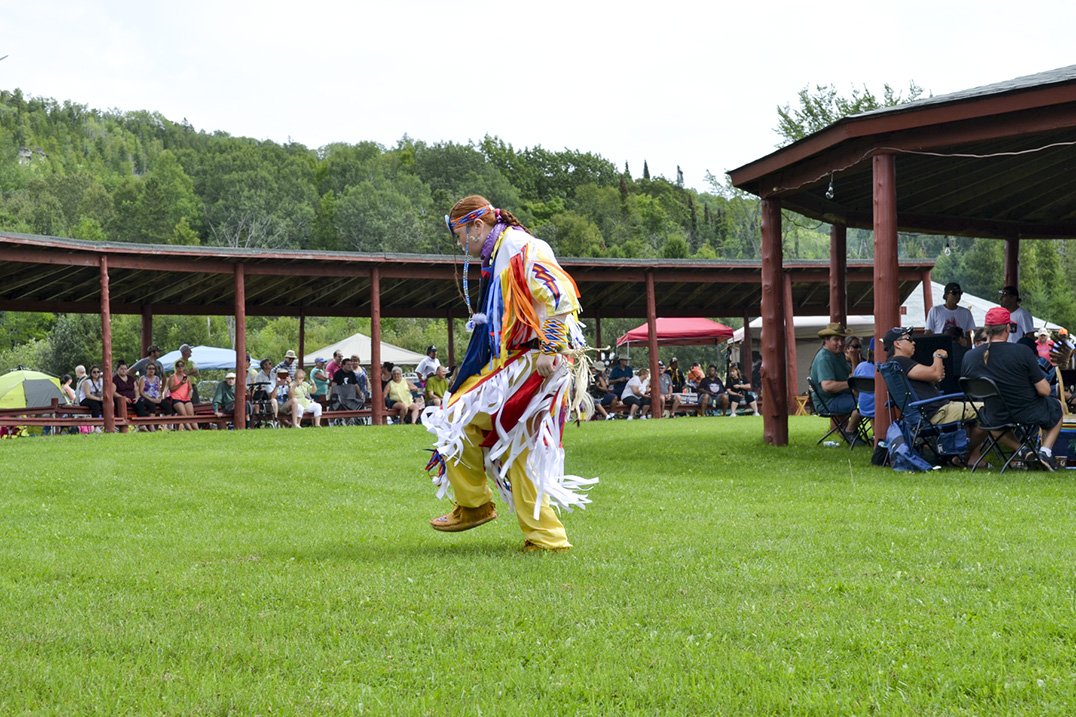 Grass dancer Shade Kaiser of M'Chigeeng cleanses the powwow ground prior to grand entry on Saturday.