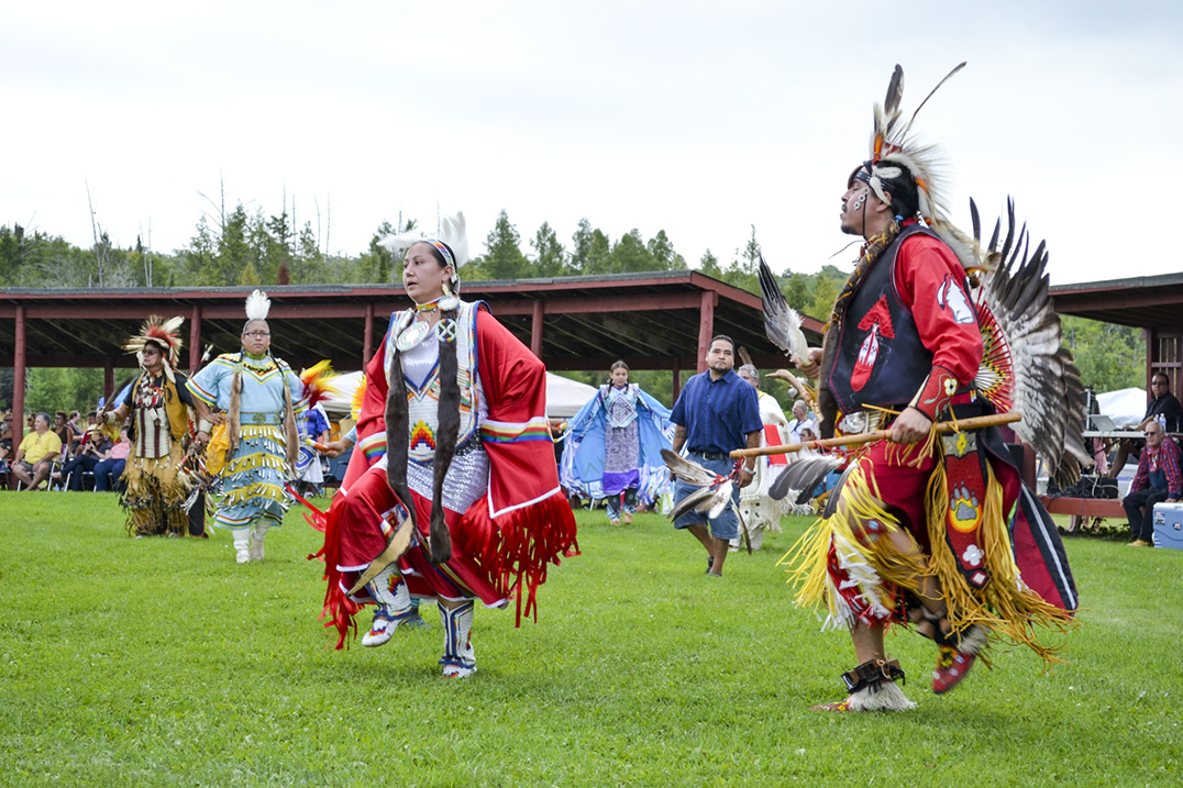 Head dancers Craig Fox and G'Mewin Migwans dance in the first intertribal of the weekend. photos by Robin Burridge