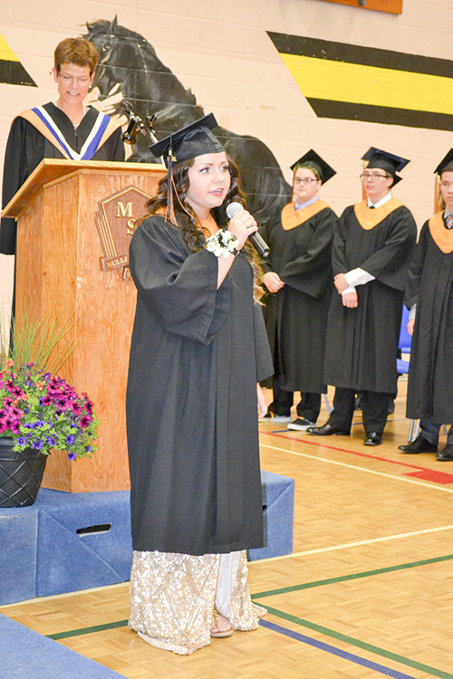 Taylor Van Horn leads the graduating class and audience in the singing of O'Canada.