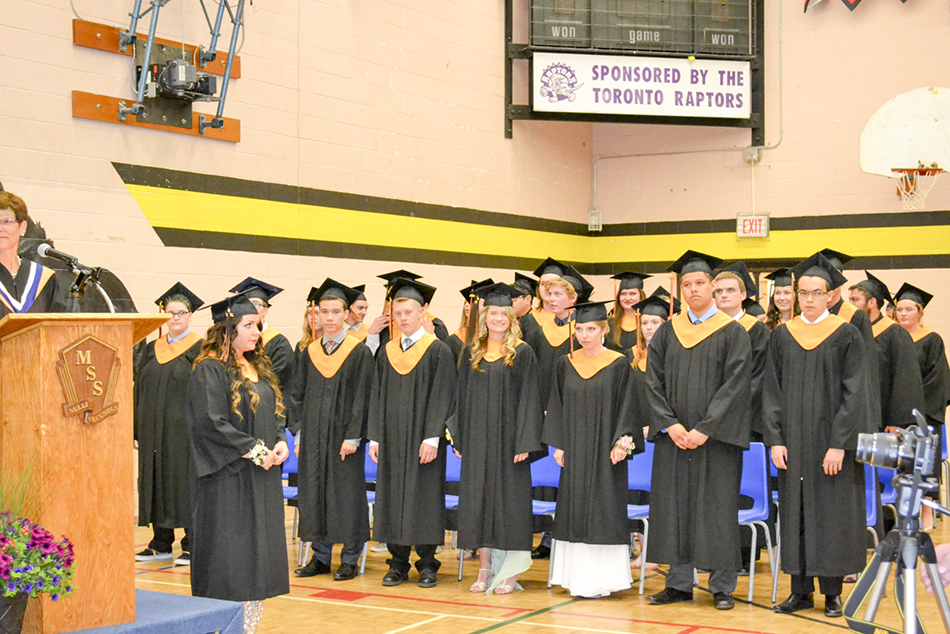 The Manitoulin Secondary School Class of 2015 graduates flank the stage at the high school. photos by Robin Burridge