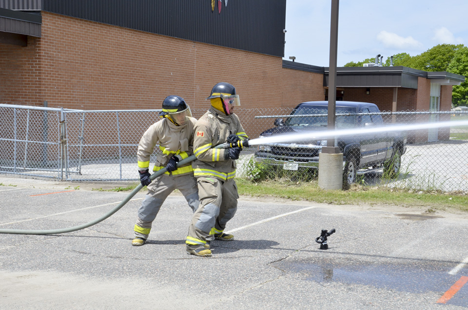 Fire teams competed in a number of skilled drills that focussed on essential firefighting tasks. photo by Michael Erskine