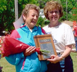 Gore Bay's 2004 Citizen of the Year being presented with her plaque on July 1, 2004