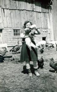 Rhea at 16 enjoying her pet lamb at home.