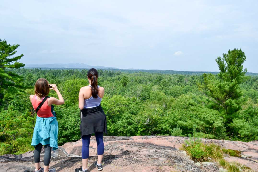 Hikers enjoy the view from Recollect's Summit as part of the Merv's Landing 6 km looping trail.