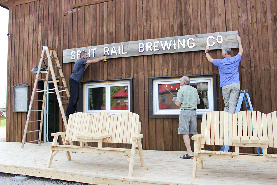 Split Rail hangs its official sign at its Gore Bay brewery.
