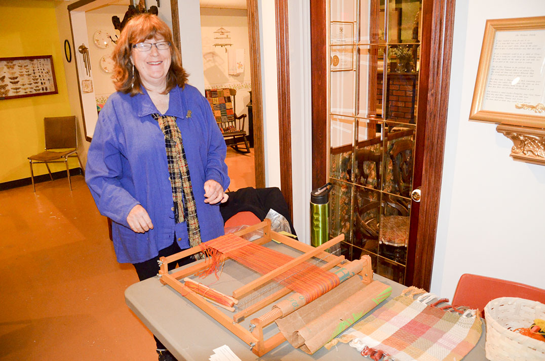 Weaver Jane Little turns the yarn into cloth in the final step.