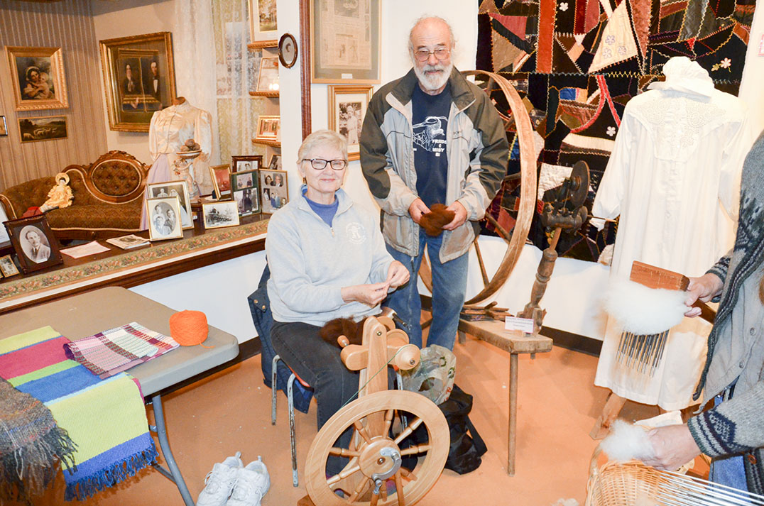 Master spinner Linda Noble turns the wool into yarn in step two as Richard Lathwell looks on.