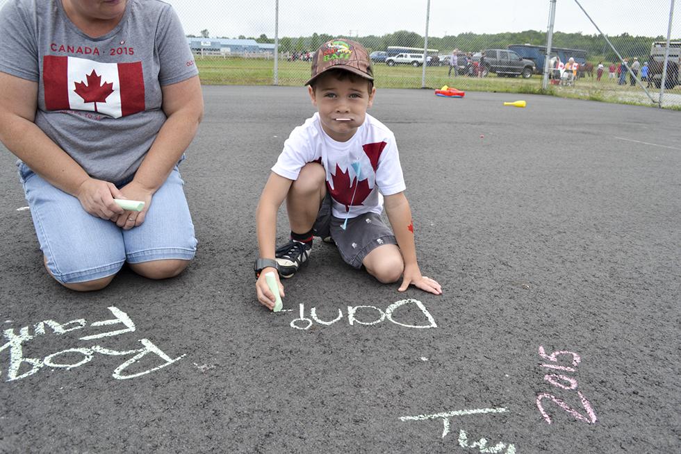Daniel Roque, age 6, enjoys the kids station at Summerfest.