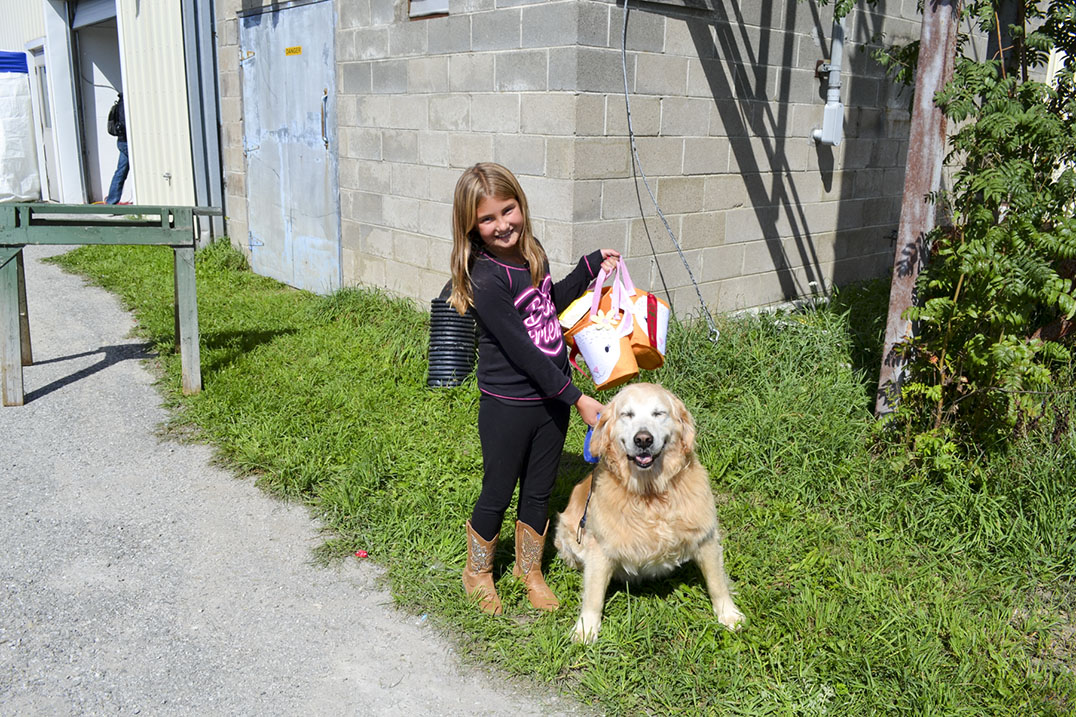 Ava Fields, 8, and Sniper. Sniper was the winner of the biggest dog, best behaved and best tricks prizes in the pet show.
