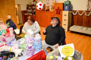A fine fair Jim Chrysler tosses one of his soft machine-washable balls into the air at his wife Sandra's booth during the annual Little Current United Church Christmas Craft Sale. The Chryslers joined a host of other vendors in offering up plenty of hand-crafted items perfect for Christmas giving to that special someone. photo by Michael Erskine