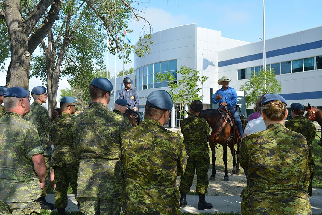 Vets ride-Paul speaks in front of 17 Wing Headquarters