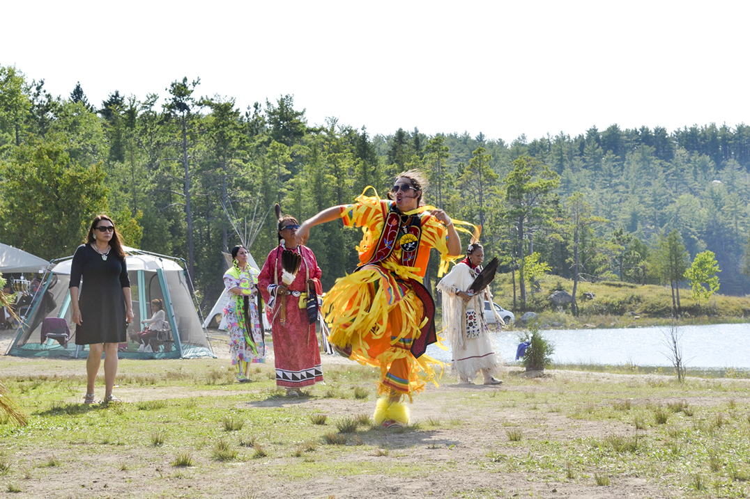 Dancers move to the beat of the drum as they make their way around the powwow arena.