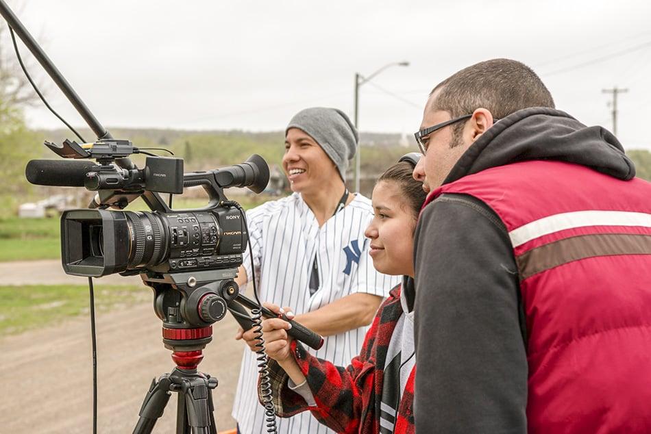 Curtis, Arcadia and Kyle take in a camera workshop with Wapikoni's Matthieu Buzzetti.