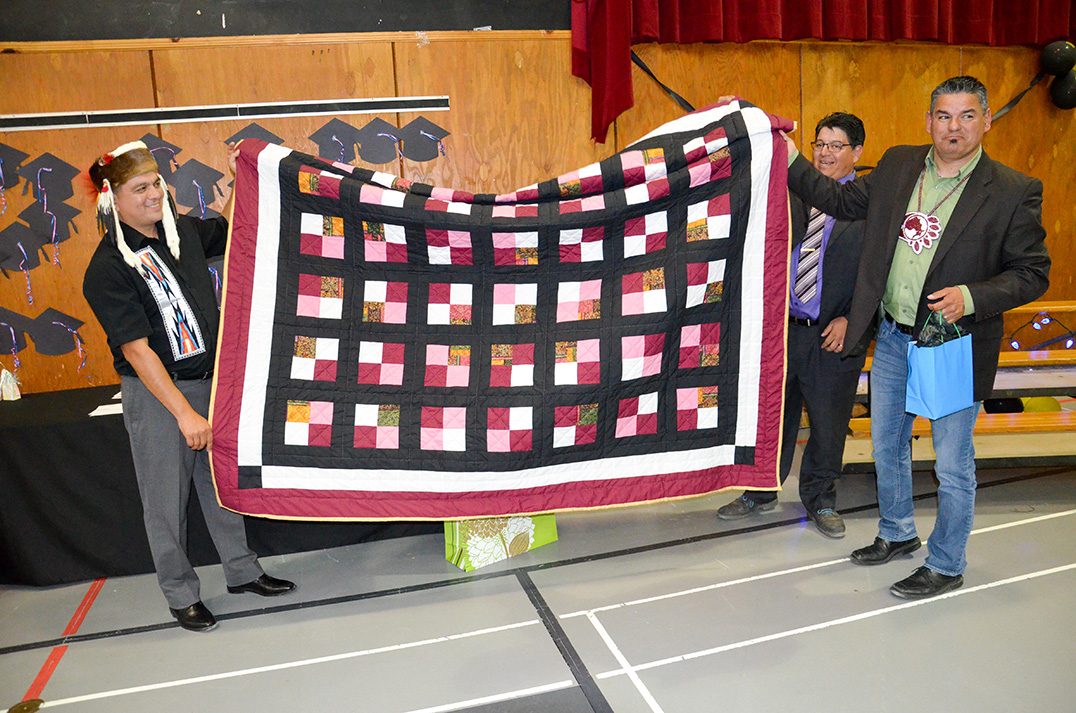 Chief Duke Peltier presents Assembly of First Nations Ontario regional chief Isadore Day with a quilt at the ceremony last week.