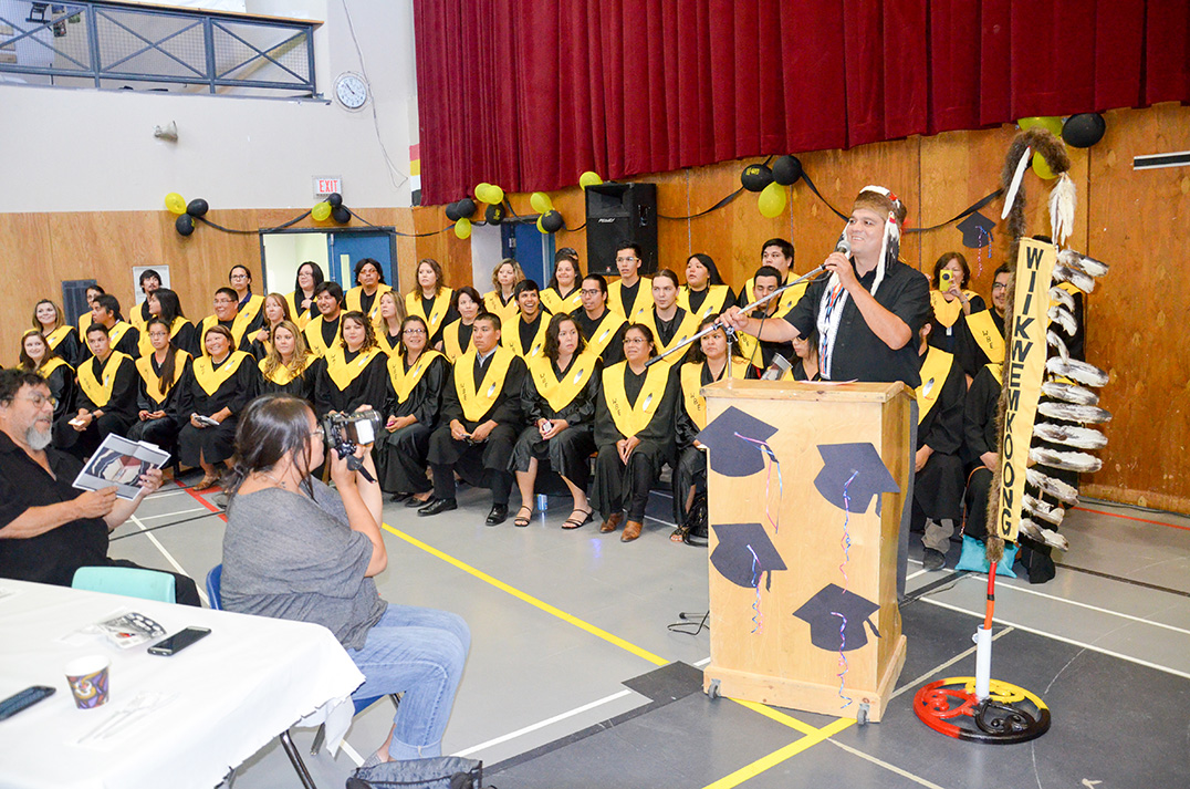 Wikwemikong Chief Duke Peltier gives a welcoming address to the post secondary graduates. photos by Michael Erskine