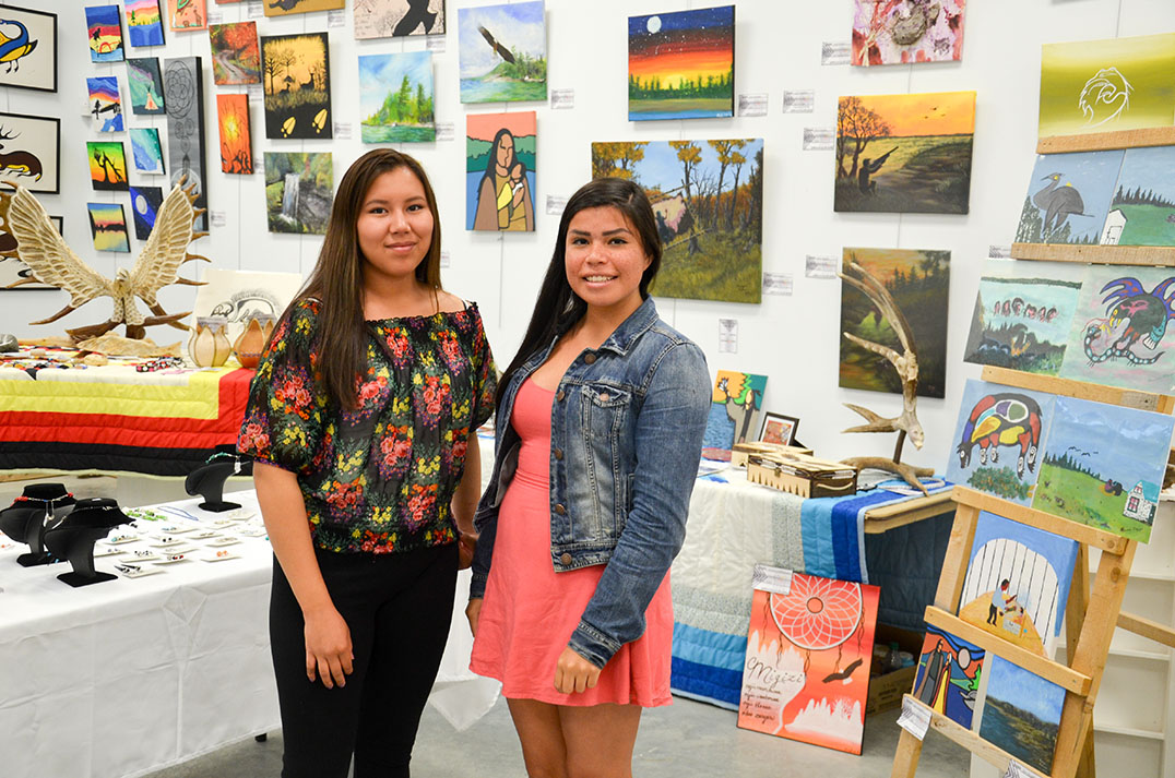 Art gallery summer art students  Evangelista Noakwegijig and Tessa Ominka were ready for the powwow crowds.