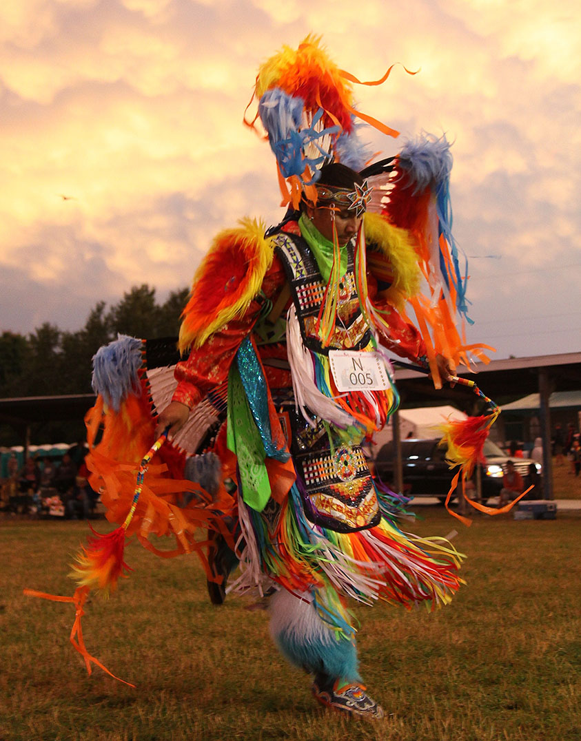 The splendour and pageantry of a competition powwow is exemplified by the colourful regalia of the fancy dancers as they go through their energetic moves in the  arena. photo by Bruno Henry