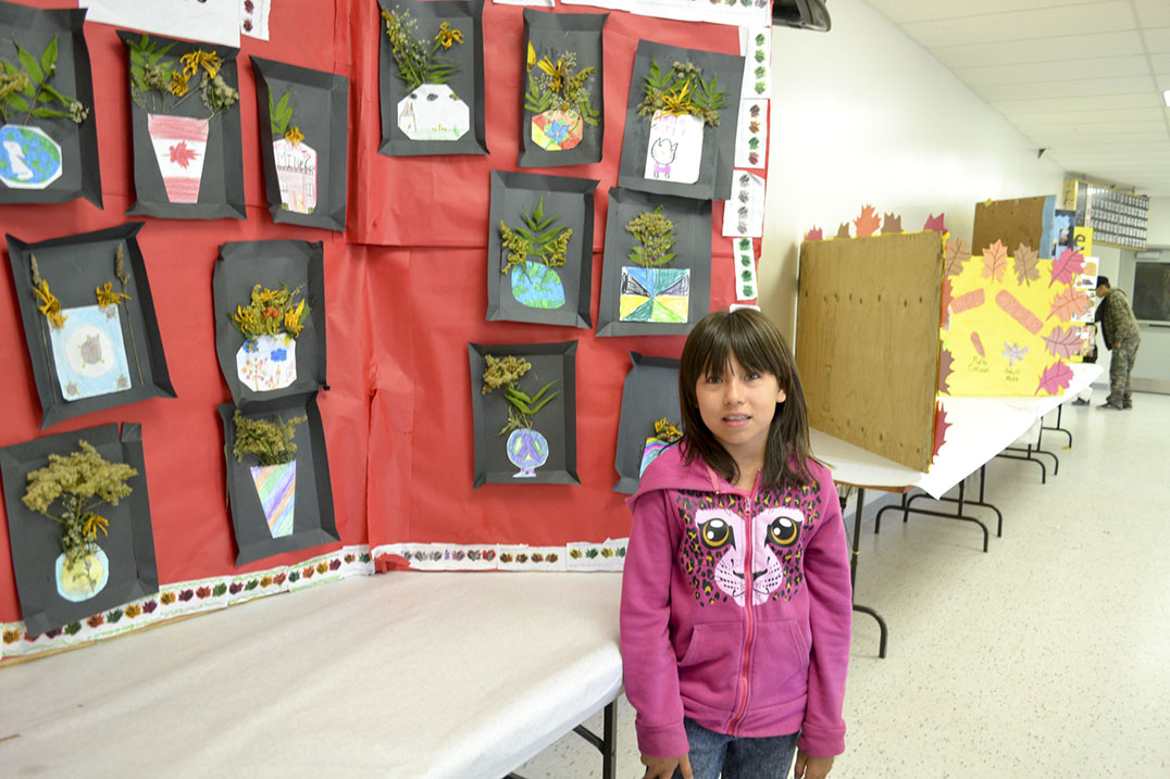 Lakeisha Peltier, 10, shows off her exhibit at the Wikwemikong Fall Fair that was on display with her class' work.