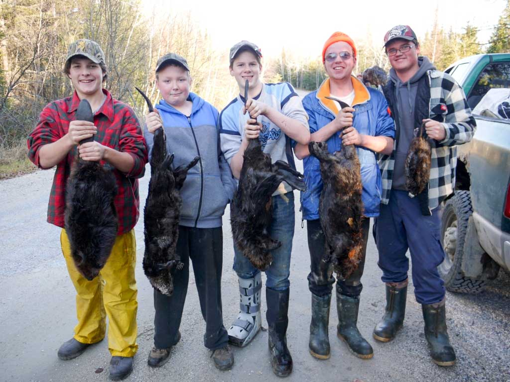 Tyler Hughson of Manitowaning, Tristan Golder of Little Current, Jadon Pearson of Tehkummah,  Michael Quackenbush of  Manitowaning and Mathew Lockhart of Evansville show off the fruits from their trapping course labours.