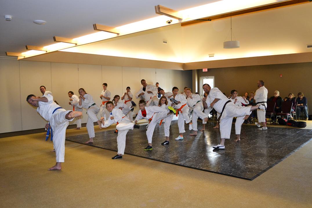 Sempai Mackenzie Cortes and Sempai Brian Boyle lead the class in a kata. photo by Alicia McCutcheon