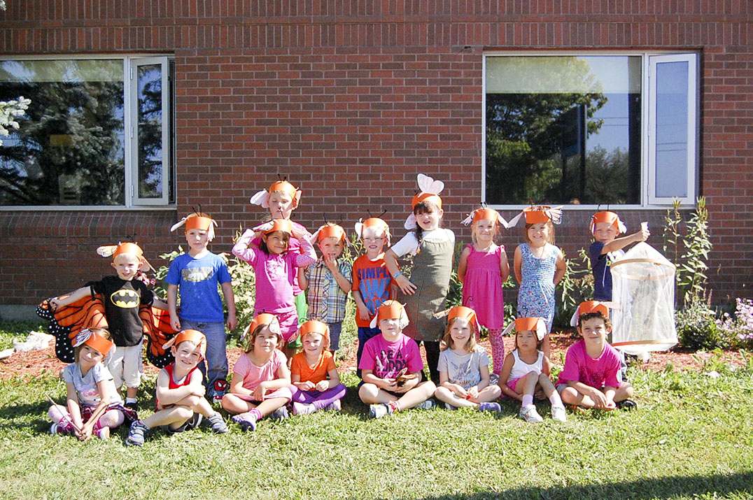 Mrs. Peltier's and Mrs. McCarville's Kindergarten class at Assiginack Public School display their butterfly charges with pride.