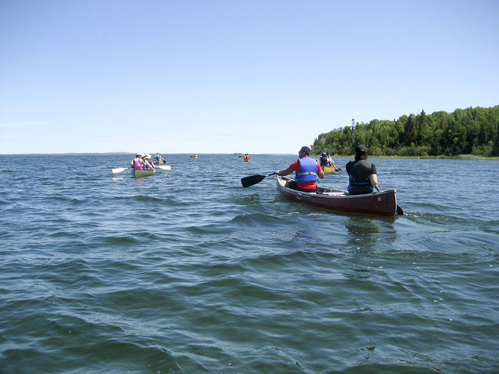Participants head out on Mudge Bay for a day of paddling instruction and skills building.