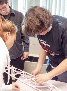 Wikwemikong High SchoolScience Olympic Team during the arm build. From left is Raven Manitowabi, Tim Pitawanakwat, and Reynold Assiniwe.