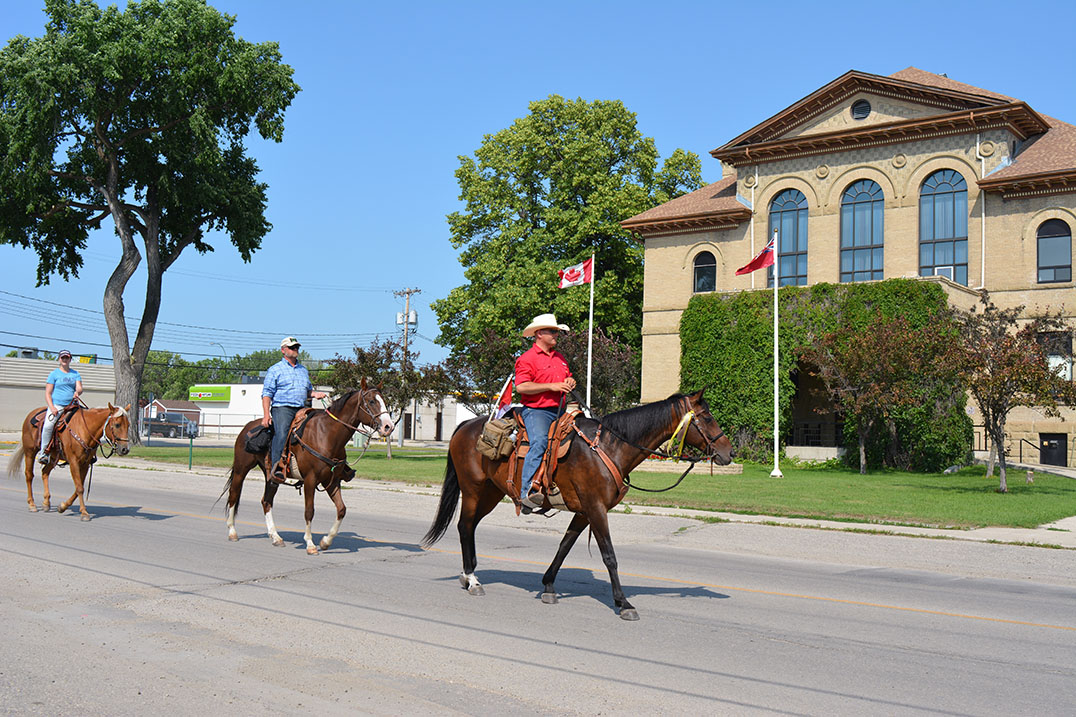 From left Erin Weigelt, a former Med Tech with 1 Field Ambulance, Sgt. William Webb, who is currently serving at CFB Shilo with 1 RCHA (Royal Canadian Horse Artillery) and has done two tours to Afghanistan, and Paul Nichols ride through downtown Portage la Prairie, July 10.